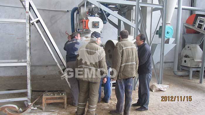 GEMCO worker on-site establishing pellet plant